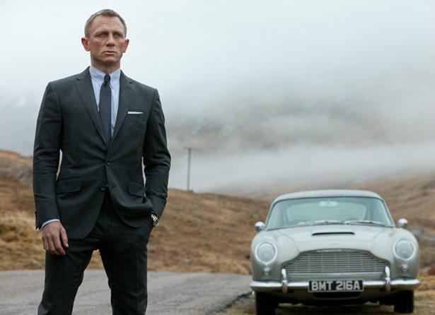 James Bond posing with Vintage Aston Martin for Skyfall