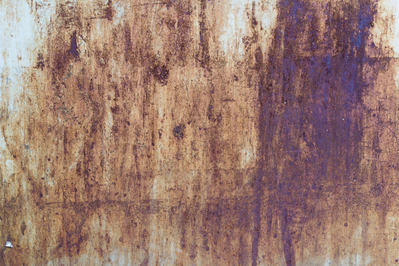 divoké texty - výstřední-zrezivělý-kov-list-II